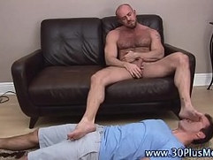Tugging bear gets feet licked